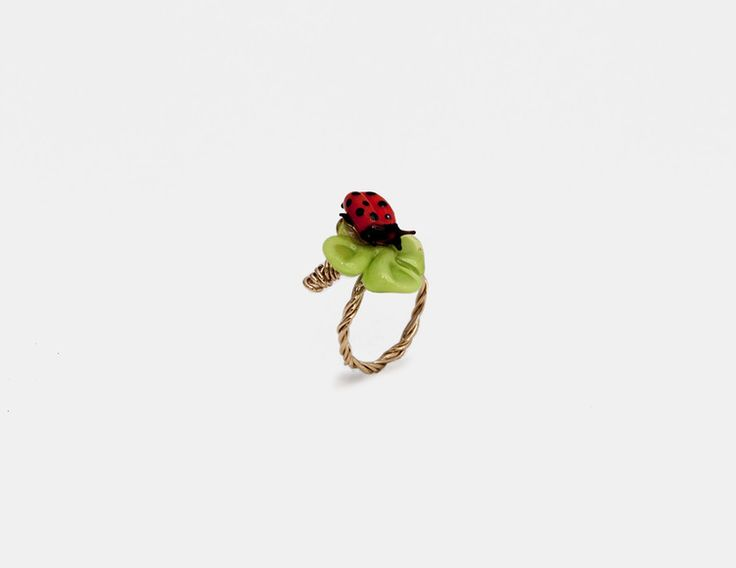Stefano Poletti - Ladybug Ring 110.00 The lady bug ring is part of the Eden jewelry collection by artist Stefano Poletti. Inspired by a trip the the La Guidecca island of Venice, the Eden collection is impossibly delicate with dangling slender blades of grass and bouquets of flowers and clovers. The Eden collection transports you to an enchanted garden of extreme fragility and beauty.  Product Style Made In France 18-Karat Gold-Filled, Murano Glass Size: 4.5 (Adjustable)