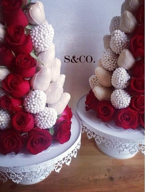 White chocolate covered strawberry tower with roses.