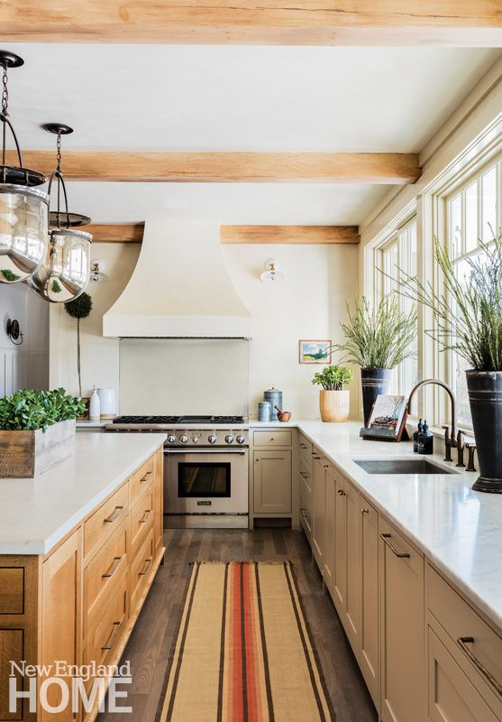 Light From A Bank Of Oversized Windows Washes The Concrete Counters And Kitchen Island Top