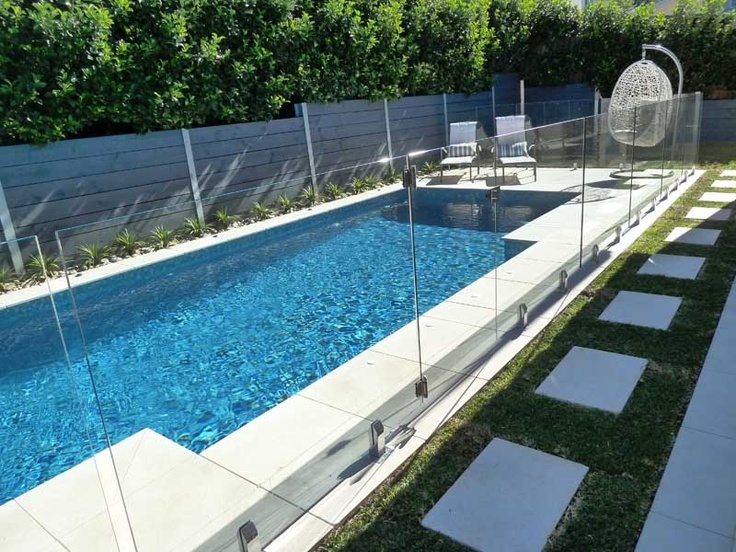 Pavers as walkway around pool on fence side but with stones around instead of grass