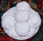 Kourabiedes, traditional Greek cookies, is one of the two kinds of cookies that are traditionally consumed in large quantities in Greece during the holiday season. The other is Melomacarona. Kourabiedes (kou-ra-bi-ETH-es)', is the plural of the word Kourabies (kou-ra-bi-ES).