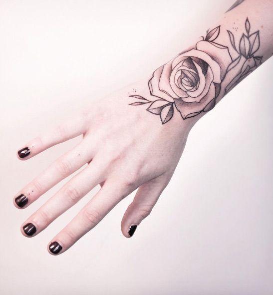 Rose wrist tattoo by Melina Wendlandt