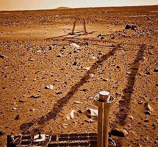 Tracks in the Martian soil made by the Spirit rover.