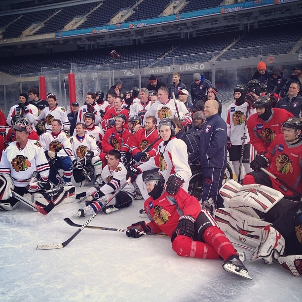 The Blackhawks and Wounded Warriors pose together after a spirited scrimmage.
