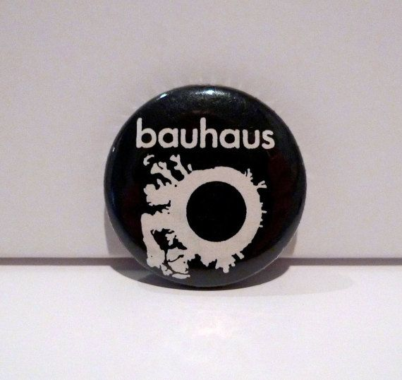 Bauhaus vintage pinback button ----- 1980s -- The Skys Gone Out Pin 1982  1.25 inch button in very good vintage condition -- deadstock from our record store with very minor shelf wear. Looks close to new. Features the album cover art.  1982 Album features -- Third Uncle/ Silent Hedges/ In The Night/ Swing The Heartache/Spirit / The Three Shadows (part1)/ The Three Shadows (part2)/ The Three Shadows (part3)/ All We Ever Wanted Was Everything/ Exquis...