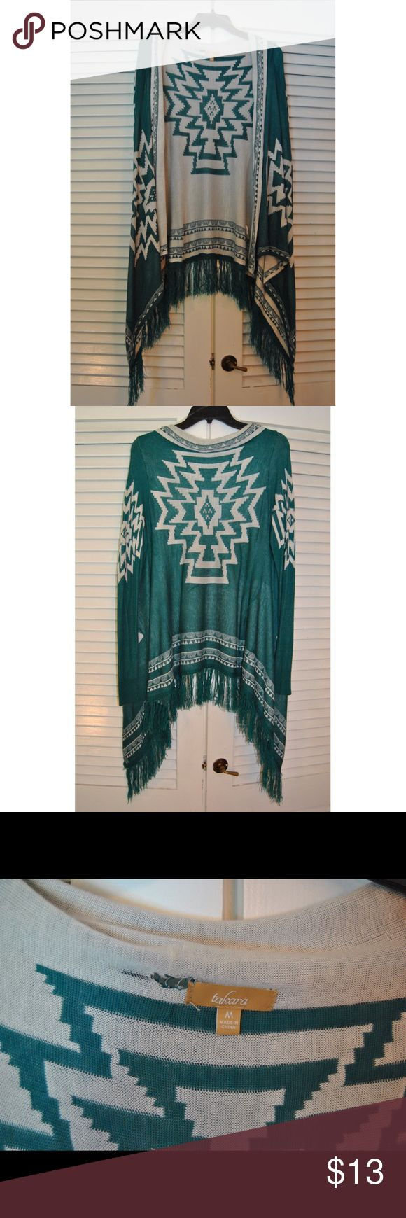 Aztec Cardigan!! Size Medium!! This Turquoise cardigan is SO cute!!! There is a hole by the tag but that's easily covered up with the fabric that falls on top of it-- other than that it's in great condition!! if you have any questions please comment below!!:) Sweaters Cardigans