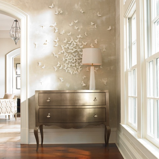 Butterfly Installation....heirloom philosophy: Making an Entrance: Caracole Furniture.  Love the metallic furniture. Adding to my DIY wishlist!