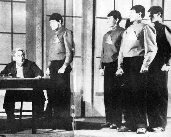 Alquist and the robots in a 1920s New York production of Karel Capek's R.U.R.