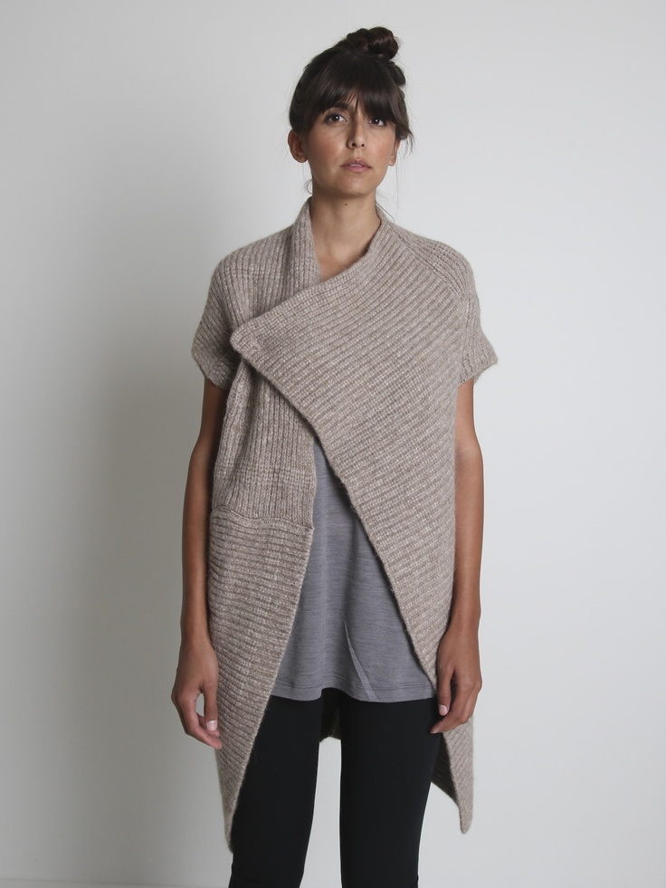 alessandra marchi    From Alessandra Marchi this asymmetrical cocoon cardigan is comprised of large pieces of ribbed knit assembled with juxtaposing grains so the biases  drape ideally with the shape of the piece, with a knit pocket at the right hip, a large eye hook closes the garment. Model wears size 42