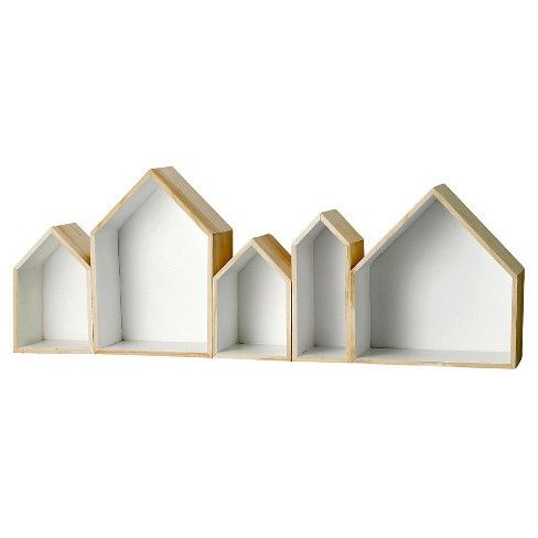 3R Studios' Wood House-Shaped Wall Shelf offers a charming way to showcase special trinkets and small memorabilia. Framed in natural wood with a chic white interior, it has multiple shelves of different shapes and sizes.