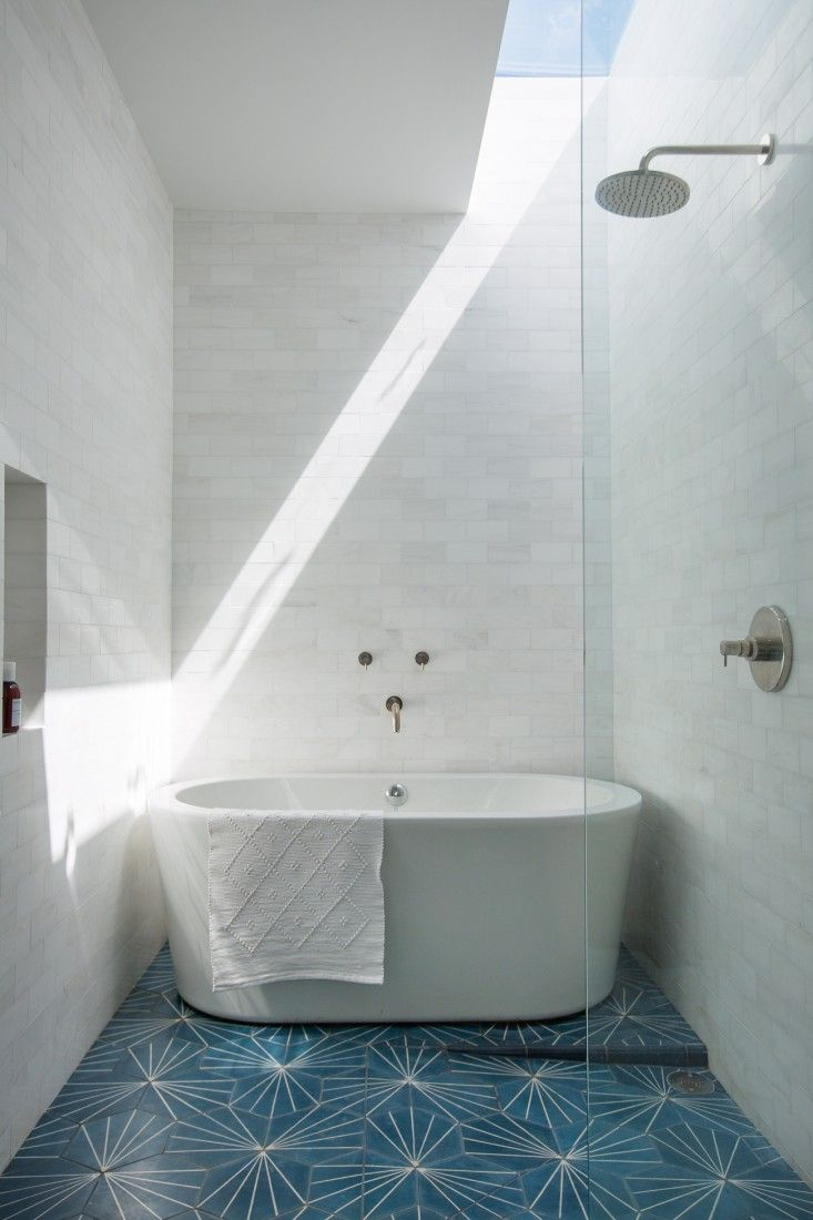 White Thassos tiles on walls and blue and white Moroccan Tiles from Claesson Kovisto Rune in Master Bathroom of Murnane House in Los Angeles by Project M Plus | Remodelista