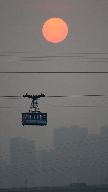 Chongqing Cable Car Sunset - 9393 by tropical.pete, via Flickr                                                                                                                                                                                 More