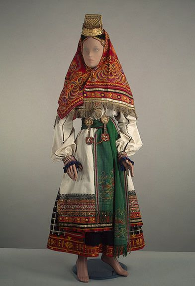 "Russian popular dress, Late 19th-early 20th century. Paneva (skirt), shirt, shushpan (jacket), apron, ""Magpie"" headdress. Hermitage."