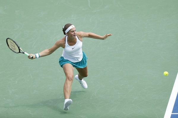 Jelena Ostapenko Photos Photos - Jelena Ostapenko of Latvia hits a return to Karolina Pliskova of the Czech Republic on Day 4 of the Western & Southern Open at the Lindner Family Tennis Center on August 16, 2016 in Mason, Ohio. - Western & Southern Open - Day 4