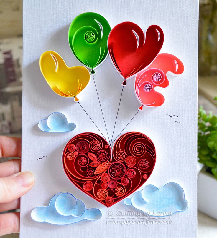 Heart Hanging from Balloons Spelling Love