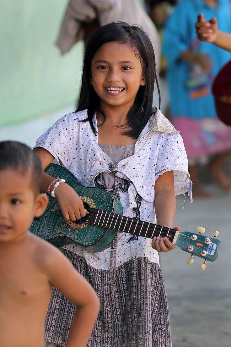 Nias girl with Ukuele, Orahili village, South Nias. Nias Island, Indonesia. Photos by Bjorn Svensson. www.visitniasisland.com