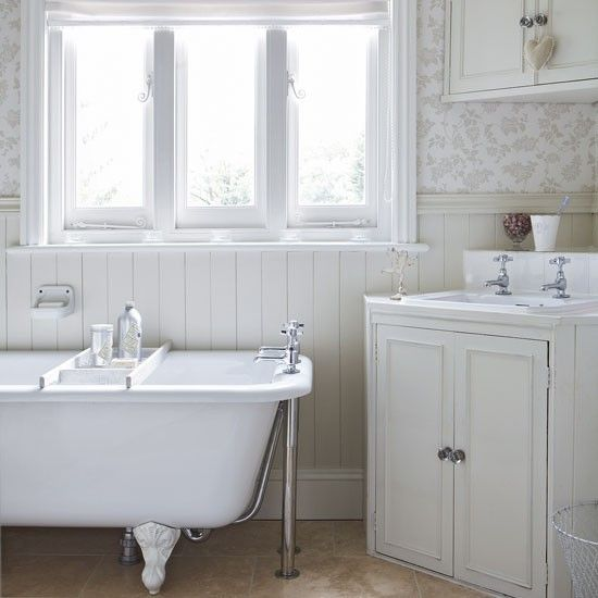 Shabby chic Victorian bathroom with freestanding bath tub