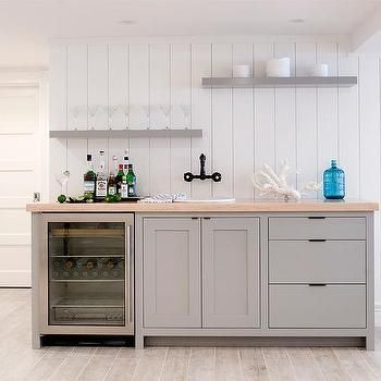 Gray Basement Wet Bar with Gray Staggered Floating Shelves