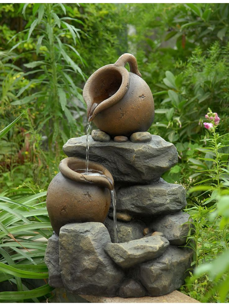 The Two Tiered Rock Water Fountain features two jugs stationed upon rocks. Water flows out of the top tipped jar and flows into the next. The perfect size, theTwo Tiered Rock Water Fountain could easi