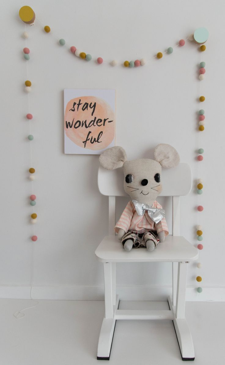 A sweet little nook, with a scandi vibe, for a girls nursery or bedroom, mustard and mint wall hooks by the HookCo looks wonderful with matching colours in this Garland by Little Puddles.  Gorgeous handmade doll, looks stunning with this 'Stay Wonder-ful' wooden banner by Simply Type.  Styling by Little Nook Interiors