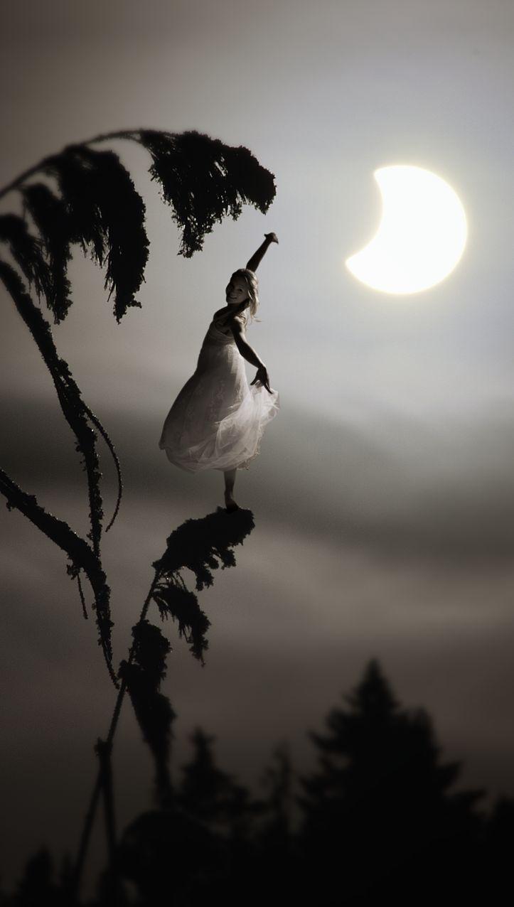 Fairy Dancer Minna Somero and the solar eclipse. Photography Janne Kommonen, post production Tuula Kainulainen.