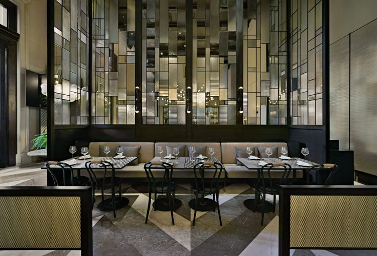 Gia restaurant and whisky bar in Jakarta: Murano inspired dividing glass screens give each space a sense of enclosure but transparency.
