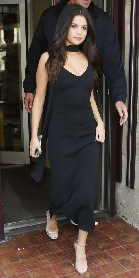 Selena Gomez in a sexy black custom Atea Oceanie slip dress.