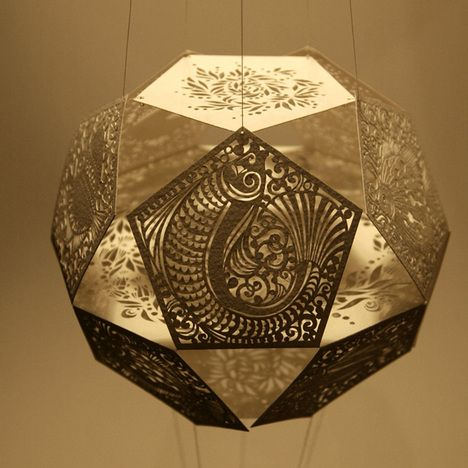 From Sara Burgess, intricate paper works cut by hand