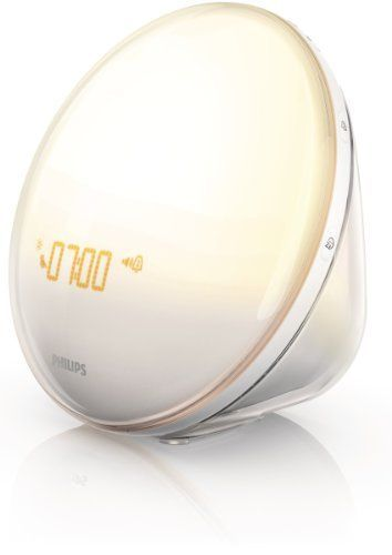 Maybe this alarm clock would get me out of bed...Philips HF3520 Wake-Up Light With Colored Sunrise Simulation, White