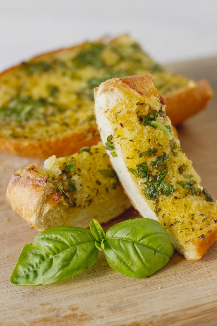Basil Garlic Toast 1 loaf of french bread, cut in half lengthwise In a food processor combine:⅓ cup butter, softened; ½ cup basil; 3 cloves garlic; ¼ cup Parmesan cheese Spread over cut halves. Season with Salt and pepper  Cook on foil at 375 for 10-15min