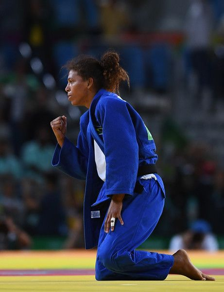 Rafaela Silva Photos - Rafaela Silva of Brazil celebrates after defeating Sumiya Dorjsuren of Mongolia in the Women's -57 kg Final - Gold Medal Contest on Day 3 of the Rio 2016 Olympic Games at Carioca Arena 2 on August 8, 2016 in Rio de Janeiro, Brazil. - Judo - Olympics: Day 3