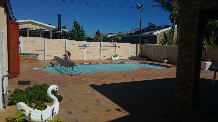 Situated in a quite area in Protea Heights,  walking distance to Bastion Primary School.This family home will suite all your needs,  3 spacious bedrooms with built in cupboards,  2 bathrooms , Lounge with braai,  separate tv room ,  dinning room,  Kitchen with a gas stove,  washing area.  Under cover area for your trailer ect,  swimming pool,  3 garages automated,   huge open parking area ,  very neat established garden.  Outside braai area.  You don't want to miss this one  Contact me…