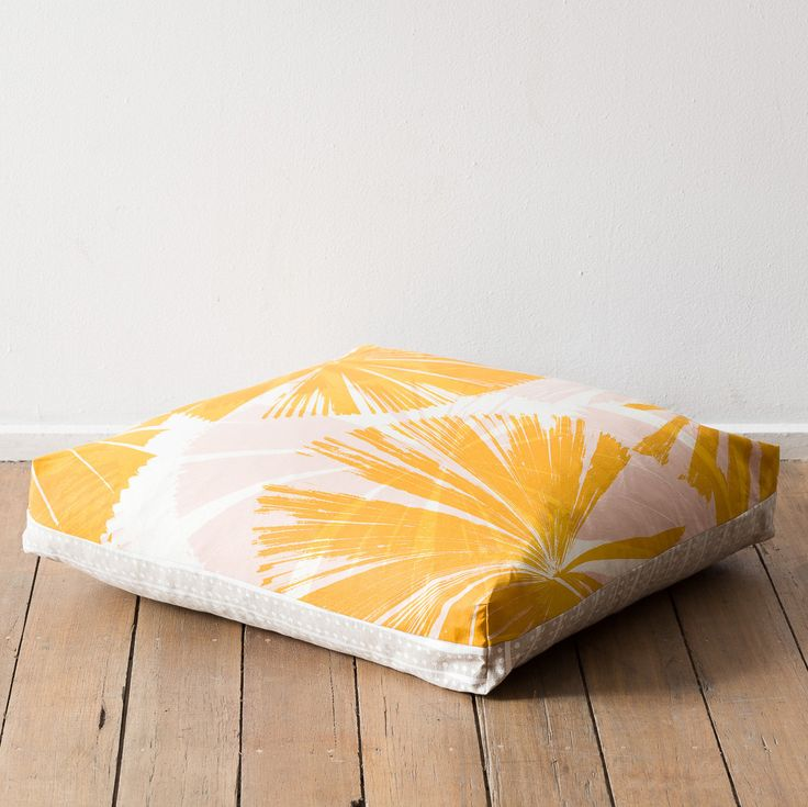 Perfect for extra guests or hanging out on the floor with your little ones are our big and comfy floor cushions! Measuring 70cm x 70cm and featuring a print on each side they're great for mixing and matching. Each cushion is made from meterage so may feature a different section of the design than that which is shown in the photos.  This cushion features Waratah in Coal & Snow and Buds in Black. An ethical feather Insert can be purchased separately. International customers are recommen...