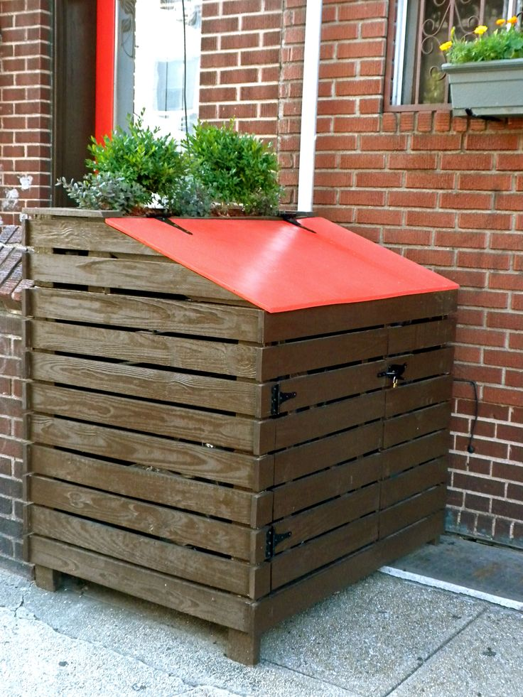 Urban trash enclosure with a planter in the back. Much better than the four beat up metal trash cans that preceded it. ***this is new wood, not made from pallets, but I guess if you can make something this nice from pallets, good for you***