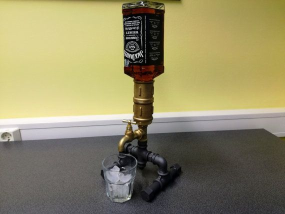Handmade, industrial beverage dispenser. This dispenser is perfect to wow your guests as you pour them a glass of whiskey or make them a mixed drink! A unique and classy way to display and serve your drink! Nor any holes and tubes, simply put a bottle in the top, ending drink - put a new