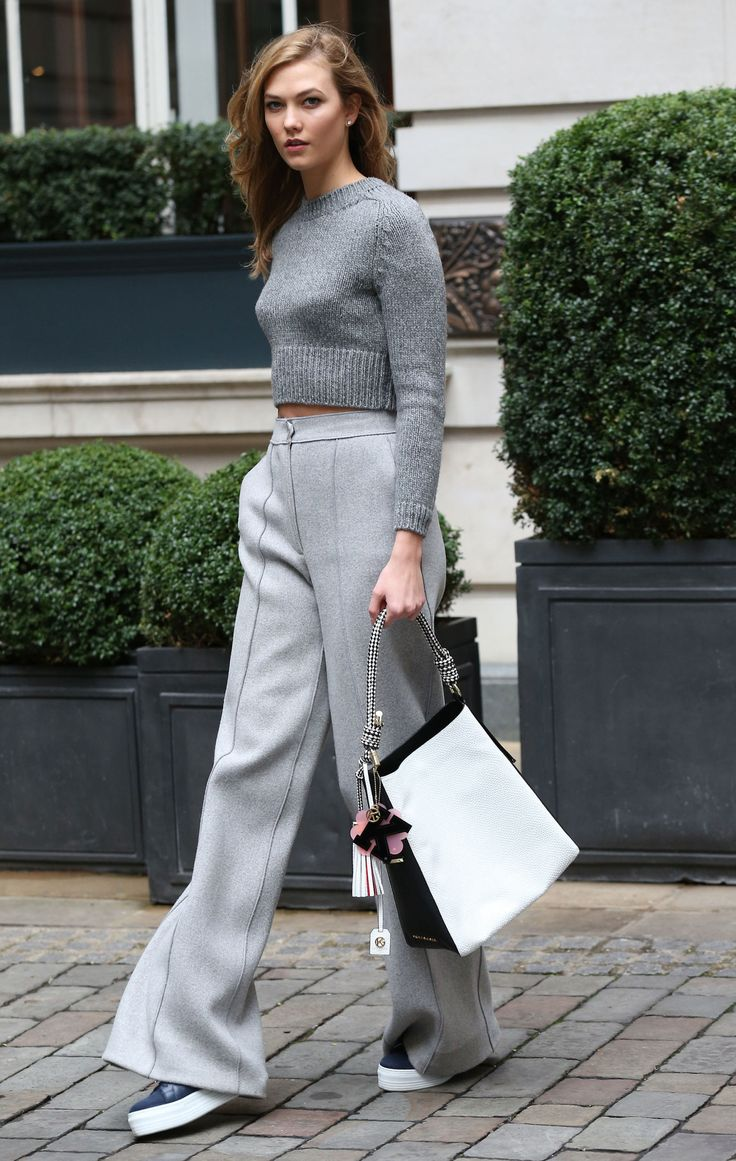 21 February Karlie Kloss was spotted out and about in London wearing grey wide-leg trousers with a matching knit and a Kurt Geiger handbag.   - HarpersBAZAAR.co.uk
