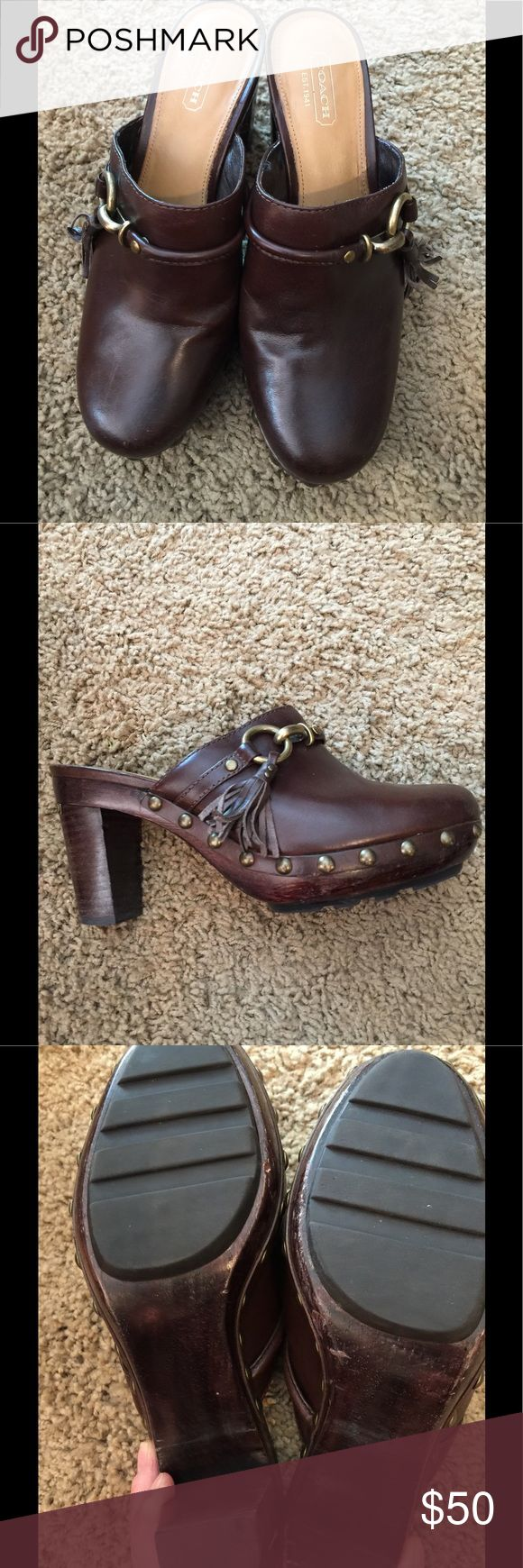 Coach clogs Brown Vachetta leather Coach clogs. 3 inch heel, one inch platform. A few scuffs on the wood clog portion but otherwise great condition. Look super cute with all styles of jeans. I bought them even though they are a 7 and I wear a 6.5 because I loved them. Still love them but they are just too big! Run very true to size. Coach Shoes Mules & Clogs
