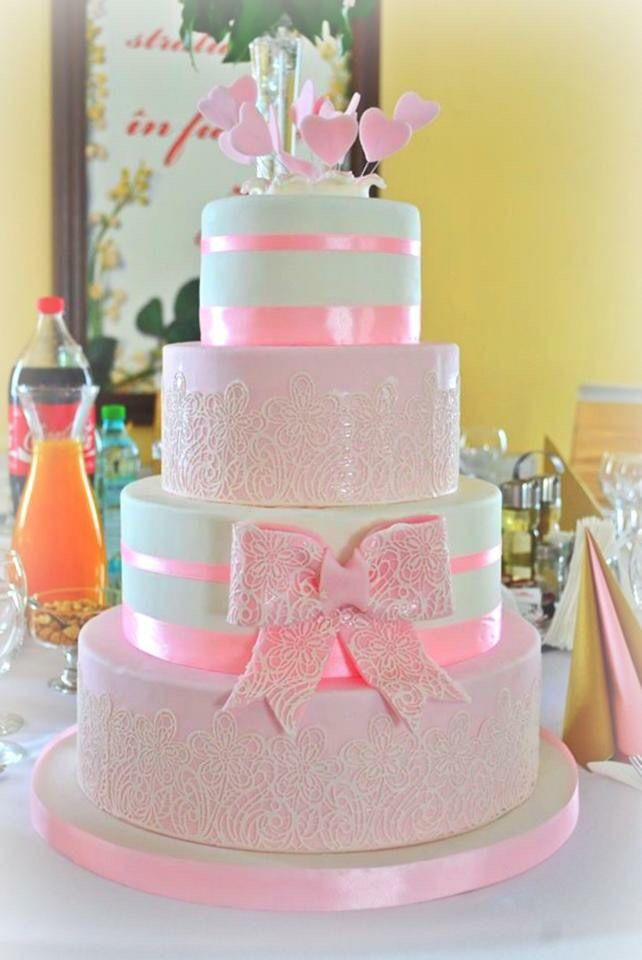 White & Pink lace wedding cake, bow and little hearts as topper