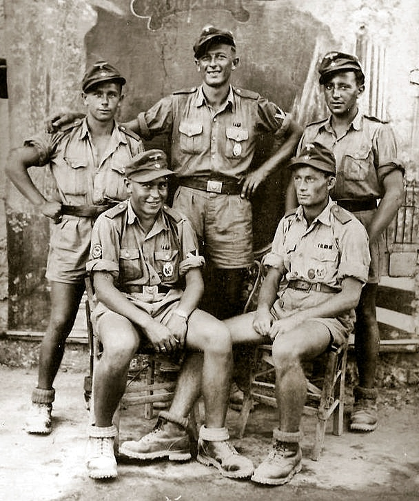 Afrika-Korps buddies pose for a group photograph at a civilian photographer's…