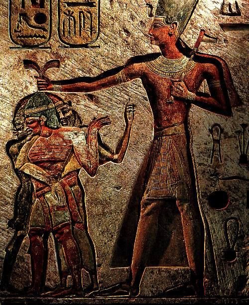 A larger-than-life Ramses II towering over his prisoners and clutching them by the hair. Limestone bas-relief from Memphis, Egypt, 1290–24 bce; in the Egyptian Museum, Cairo.........PARTAGE OF THE ANCIENT GODS..........ON FACEBOOK.........