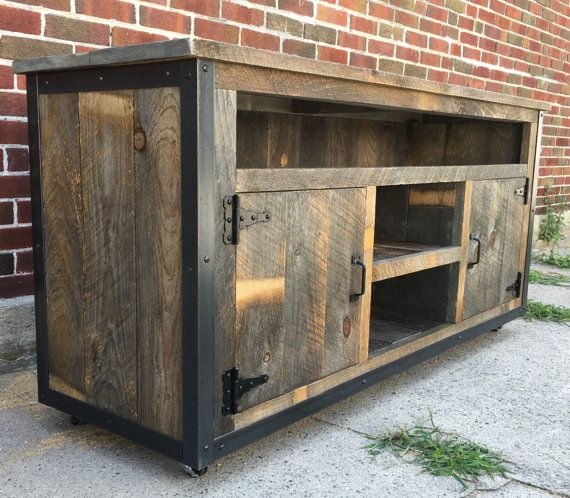 * PLEASE CONTACT US FOR A FREIGHT SHIPPING QUOTE PRIOR TO BUYING. SHIPPING COSTS ARE NOT CALCULATED UNTIL YOU CONTACT US. This stunning reclaimed wood entertainment center has been crafted from genuine weathered rough sawn barn board, steel corners and completed with barn style hinges and industrial casters. It has been sealed inside and out with zero VOC water based lacquer. Equally at home in a rustic, industrial, urban or farm style house, this entertainment center has plenty of storage…