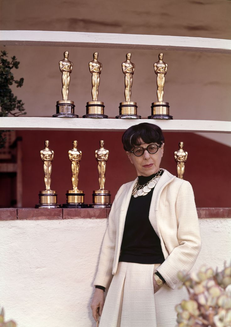 Edith Head w/ her 8 Oscars for Best Costume Design.