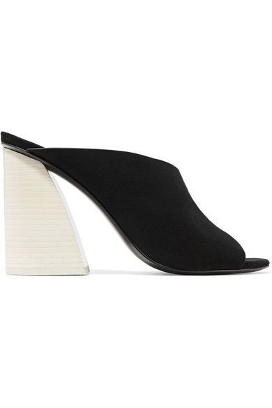 Mercedes Castillo draws inspiration for her footwear collections from artists like Michele Reginaldi and Lucio Fontana. These sleek 'Izar' mules are made from supple black suede and set on an architectural wooden heel. Keep yours in focus with cropped hemlines.