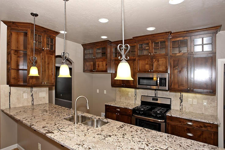 Love the contrast of the bianco antico slab granite and for Best home kitchen cabinets surrey