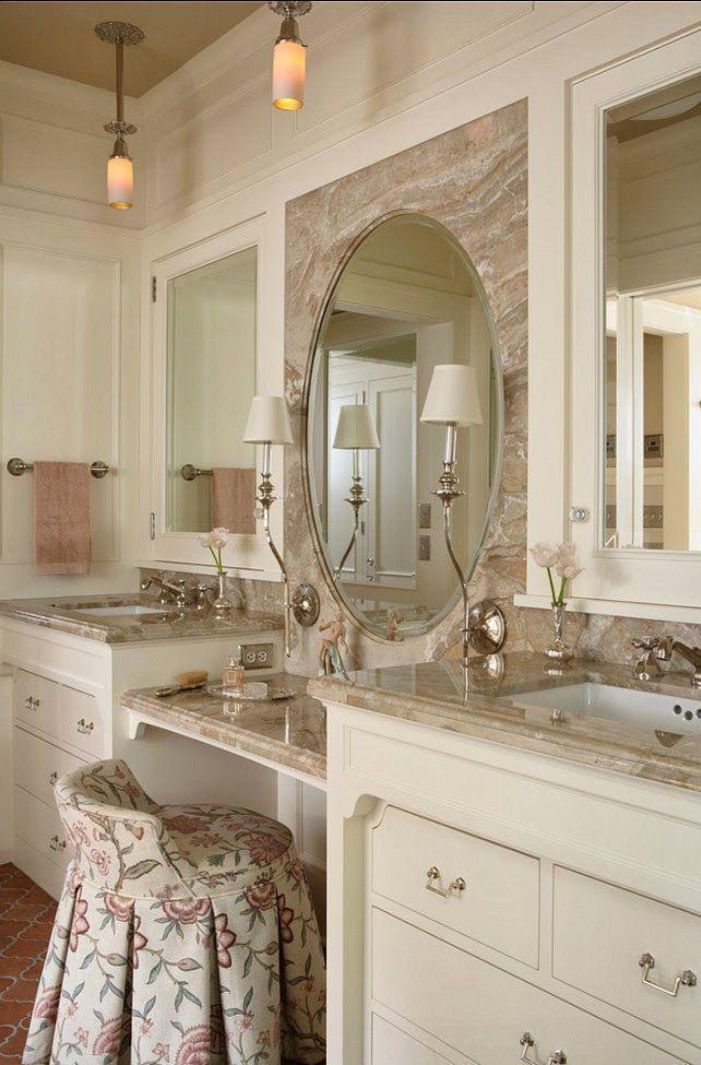 makeup area between sinks, drawers under sink