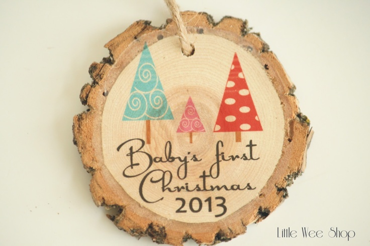 Baby's First Christmas Ornament - A Daddy and Mommy Christmas tree stand over a baby Christmas tree. This ornament can be personalized with the baby's name and can be made with a pink or blue baby tree.