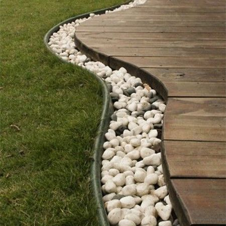 In this contemporary garden the area between deck and lawn is demarcated by adding a bed of white pebbles. A strip of lawn edging holds the pebbles in place and also allows for easy lawn maintenance and doing away with the need to use an edge trimmer or spade to keep lawn edges neat. http://www.easydiy.co.za/index.php/garden/379-easy-diy-ideas-for-beautiful-beds-and-borders