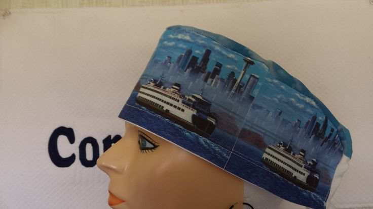 Male scrub cap imprinted with a ferry boat image covering the entire cap.  Reminiscent of the cap used in Grey's Anatomy Dr. McDreamy