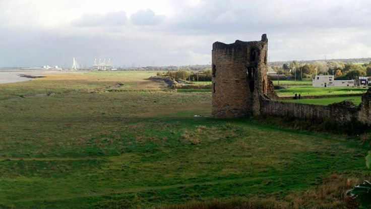 Flint Castle - Flint Castle and foreshore with Dee bridge and Connah's Quay power station in the background. Photo by Neville Layhe, of Penycae, Wrexham.