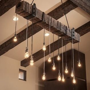 """Beautiful reclaimed wood beam chandelier - 8"""" x 8"""" x 6' reclaimed wood beam with wrought iron U brackets, suspension chains and 16 lights."""